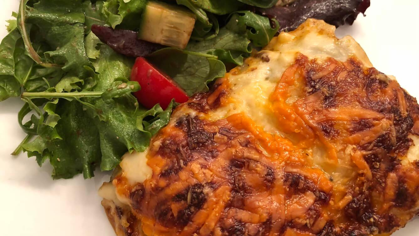 Lasagne, served up with a salad dressed simply with olive oil and balsamic vinegar